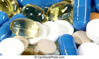 Colored pills, tablets and capsules, rotation, close up