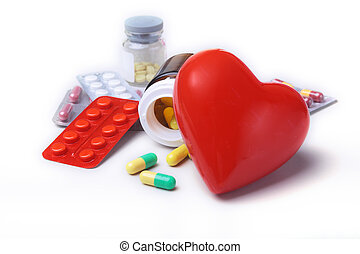 Colored Pills, Tablets, Capsules Blisters and red heart for...