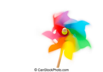 Pinwheel toy with motion blur on white background.
