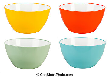 Colored plastic bowls on white background