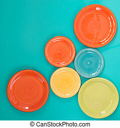 Colored plates on a turquoise background