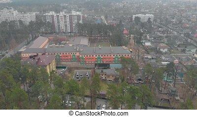 Colored school facade drone aerial view Irpin Ukraine