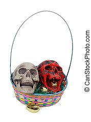Colored skulls in an Easter basket