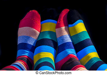 Colored socks on a Valentine couple feets
