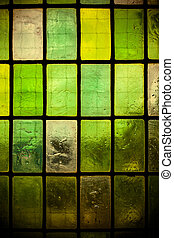 colored stained glass window with regular block pattern...