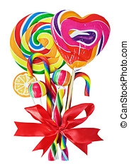 colored sweets with red ribbon bow