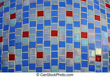 colored texture of fine ceramic square tiles with a pattern on the wall