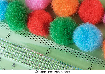 Colored volumetric background of shaggy balls for decoration close-up macro photography