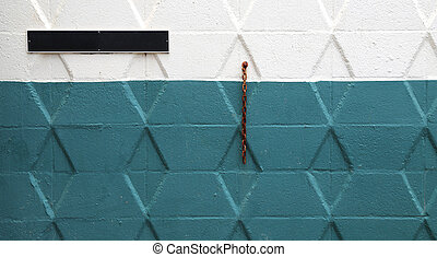 colored wall with blank sign