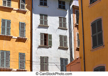 colored walls and windows in the French city