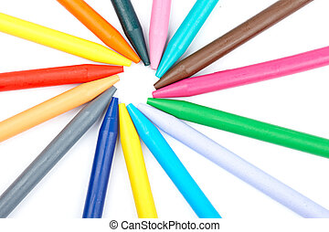 Assortment of coloured wax crayons isolated on white background. Path included