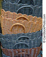 Colored wicker baskets stacked