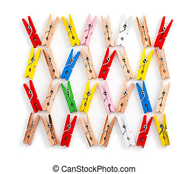 Colored wooden clothespins pattern isolated on a white background. Close up, top view.