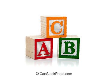 Colored wooden letter blocks on a white background