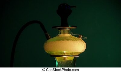 Colored yellow hookah with the smoke on Black. slow motion