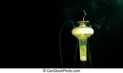 Colored yellow hookah with the smoke, slow motion