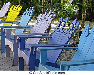 colorful tropic shaped Adirondack deck chairs outside