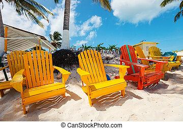 Colorful adirondack lounge chairs at Caribbean beach