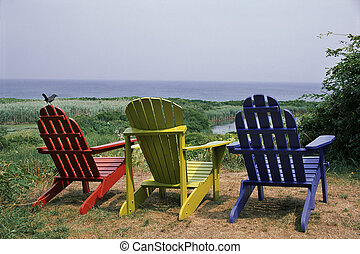 colorful adirondacks - red, green and blue adirondack chairs...