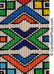 Colorful African beads depicting traditional African shapes