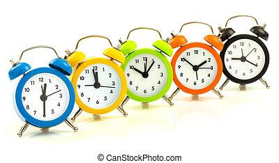 Colorful alarm clocks, align