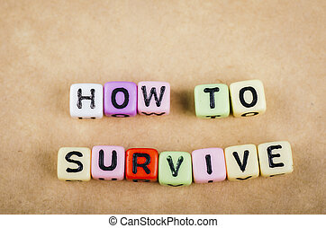Colorful alphabet letter dice text on desk, spelling HOW TO SURVIVE