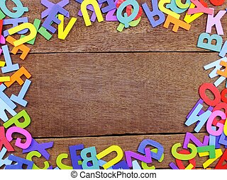 colorful alphabet letters on wooden background concept