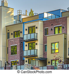 Colorful apartments in a row in Park City square
