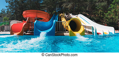 colorful aquapark in green forest - Colorful aquapark in ...