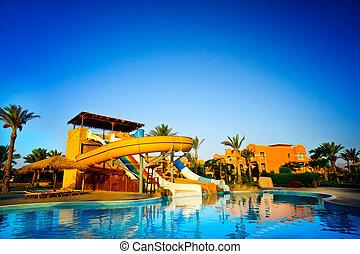 Colorful aquapark in the swimming-pool.
