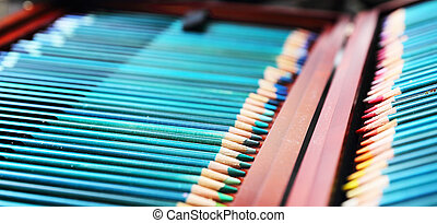 colorful art pencils in a wooden case