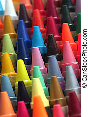 Colorful art wax crayon pencils tips for children and others arranged attractively in rows and columns making a stunning display of colors
