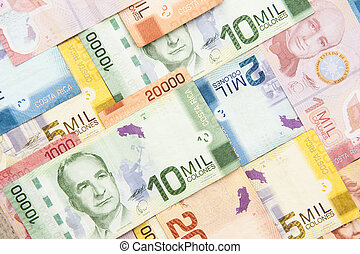 Colorful assortment of various denominations of Costa Rican Colones bills