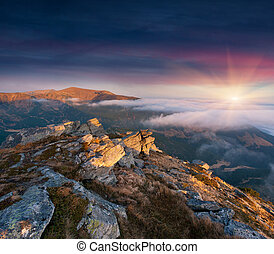 Colorful autumn landscape in the mountains. Sunrise