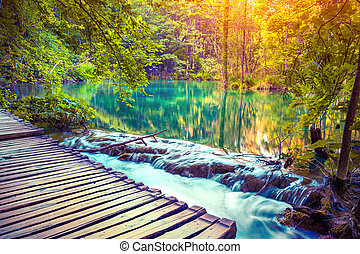 Colorful autumn sunrise in the Plitvice Lakes National Park.