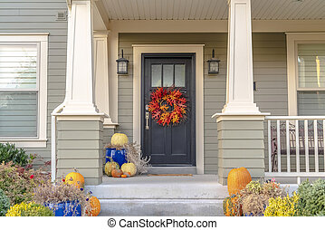 Colorful autumn wreath hanging on a front door
