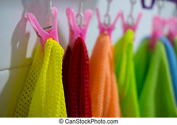 Colorful baby kids clothes hanging on clothesline