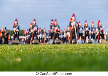 Colorful background of a music orchestra in the evening sun