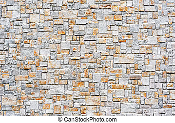 Colorful background of the stone wall texture.