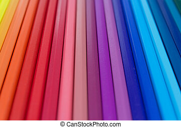 colorful background - row of color assorted pencils macro