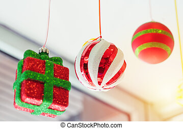 colorful ball and gift box mobile hanging on the ceiling
