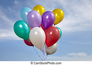 colorful ballons in a blue sky