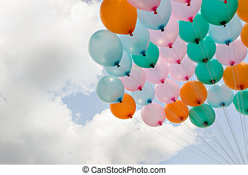 Colorful balloon on blue sky and clouds