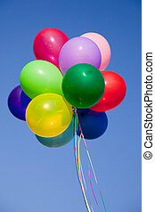 Colorful Balloons - A group of colorful balloons with blue...