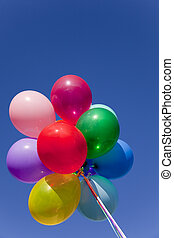 Colorful Balloons - A group of colorful balloons with blue ...