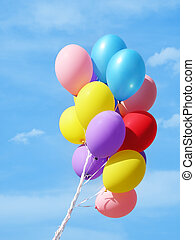 Colorful Balloons ag - Bunch of balloons against sky - ...