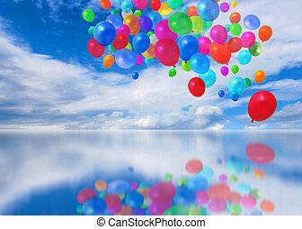 Colorful balloons on mirror cloudscape background