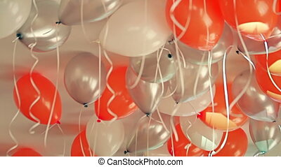 Colorful balloons filled with helium hanging from the ceiling on a children's birthday party