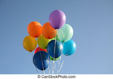 Colorful balloons in a clear blue sky