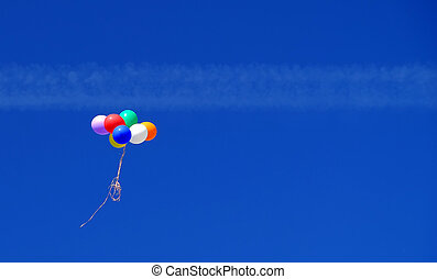 Colorful balloons in the blue sky